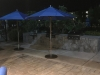 nighttime-restaurant-patio-with-umbrellas