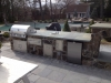 Outdoor Stone Kitchen with Sink and Gas Grill