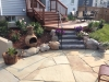 Outdoor Stone Patio with Steps and Wood Deck