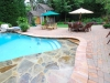 sun-deck-in-pool-with-natural-stone-veneer-bethesda-md
