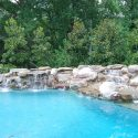 Reasons to Add a Stone Waterfall to Your Pool